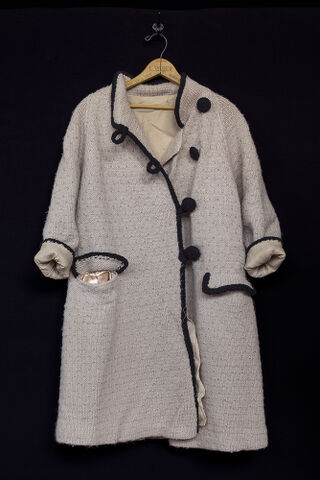Anna's handmade tan coat, black trim