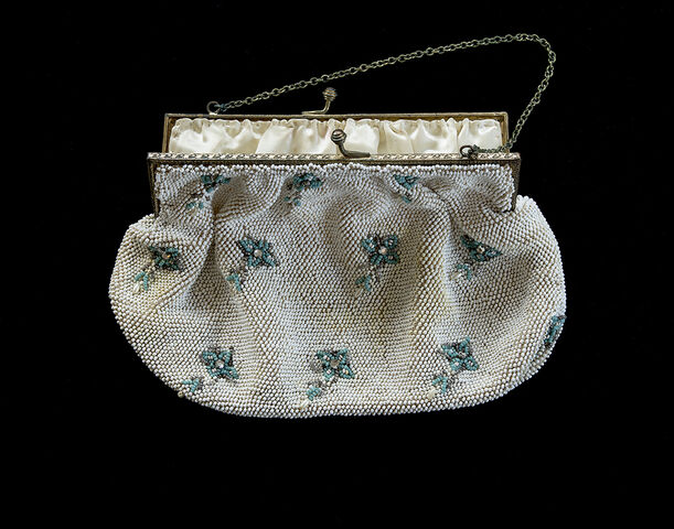 Anna's handmade white beaded bag, turquoise flowers